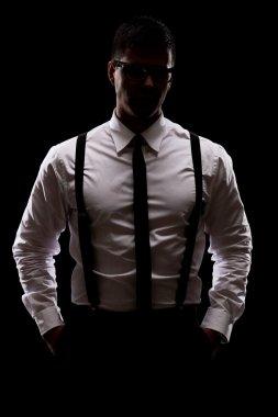 Mysterious man standing in dark