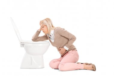 Woman throwing up in toilet