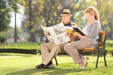 Mature couple relaxing in park