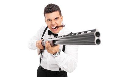 Aggressive man threatening with shotgun