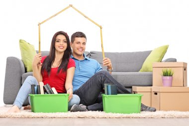 Couple sitting by moving boxes