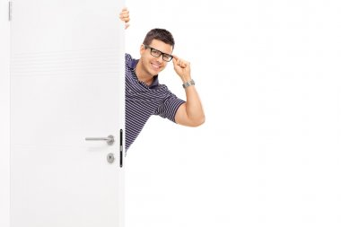Man with glasses peeking behind a door isolated on white background stock vector