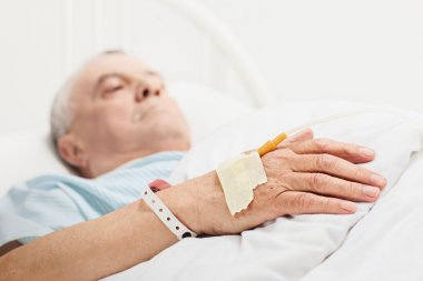 Senior lying in hospital bed