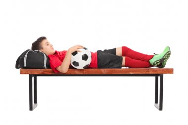 Boy in a red football jersey