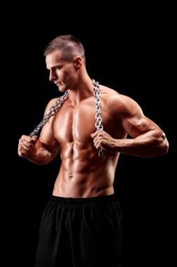 Shirtless young man holding a chain
