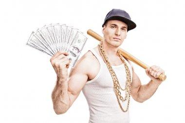 Thug holding baseball bat and money
