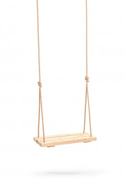 wooden swing hanging on a couple of ropes