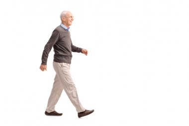 Casual senior man walking and smiling
