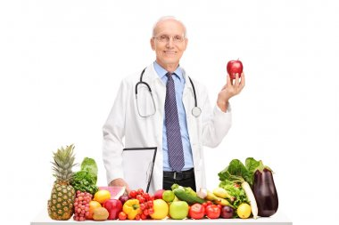 Mature doctor holding an apple