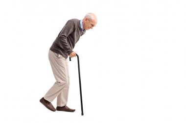 Exhausted old man walking with a cane