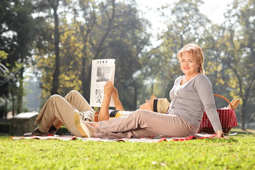 Mature woman posing in park with her husband