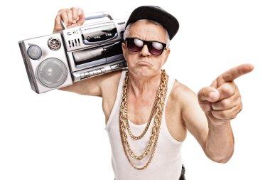 Senior rapper carrying a ghetto blaster
