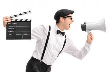 movie director holding a clapperboard and shouting