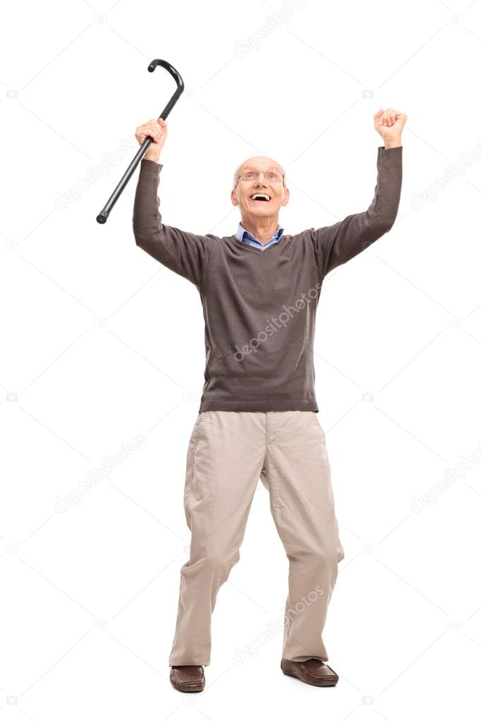 Overjoyed senior man holding a...