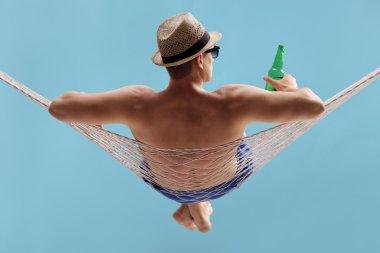 carefree man lying in a hammock