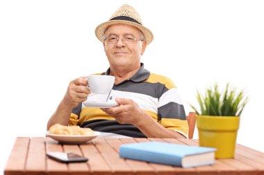Senior gentleman drinking coffee