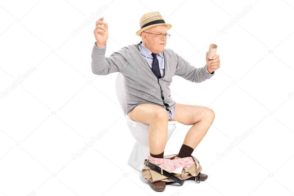 Senior Man With Empty Toilet Paper Roll Stock Photo