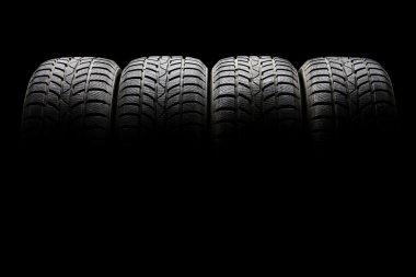 four black car tires