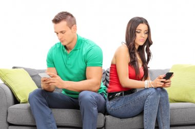 couple looking at their cell phones