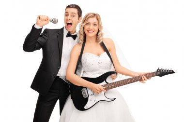 Bride playing guitar and the groom signing