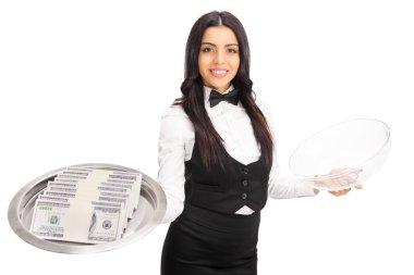 Female waitress holding a tray with money