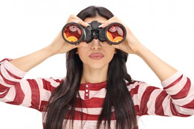 Woman looking through black binoculars