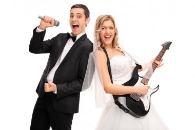 Bride playing guitar and a groom singing