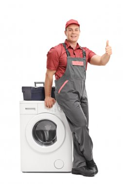Male repairman giving a thumb up