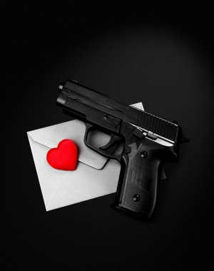 pistol red heart silver envelope on a black background