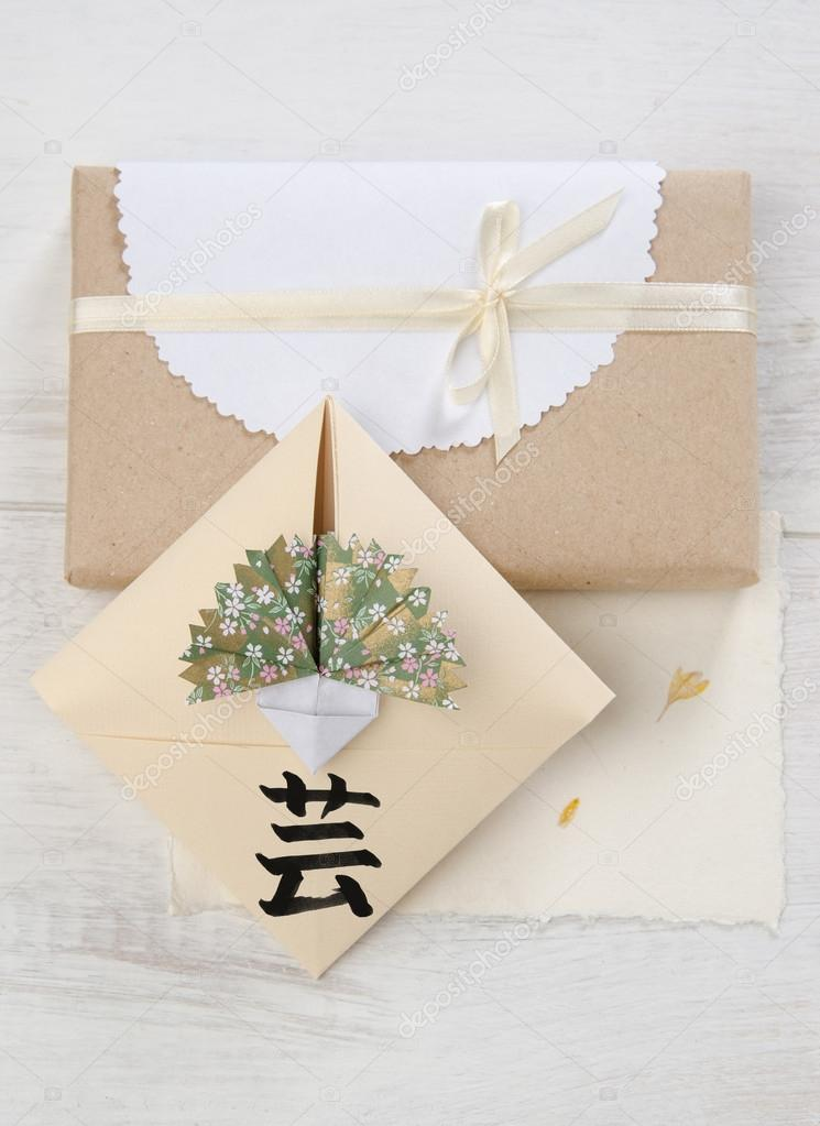 Origami envelope with cloves hieroglyph art stock photo mukhin japanese origami envelope with flower carnation hieroglyph signifying art with gift next photo by mukhin mightylinksfo