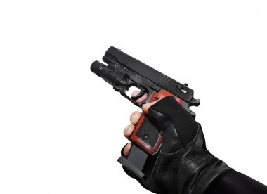 Hand holding a handgun with clip view.