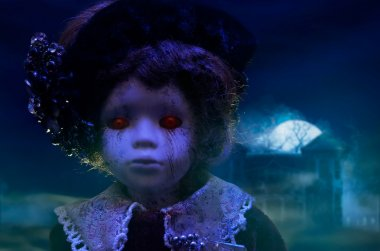 Horror doll with haunted house.