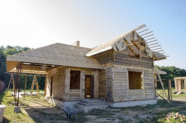Construction of houses made of wood and brick