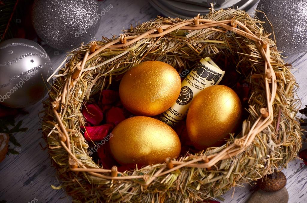 Gingerbread Cookies Of Birds On The Nest With Golden Eggs And