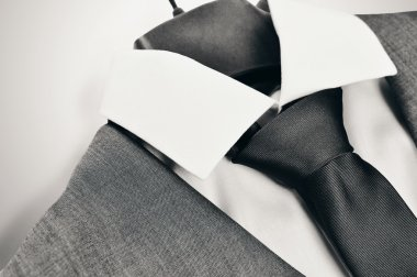 Black and white mens suit, collar and tie closeup.