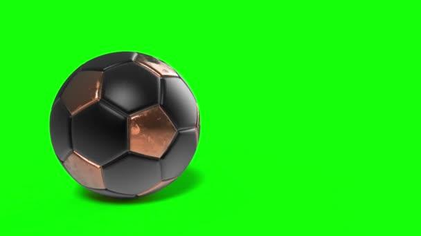 Zlatá žlutá a černá fotbalový míč, který se zapne na izolované zelené obrazovce pozadí. Vysoce kvalitní 3D vykreslování ilustrace pro fotbal.