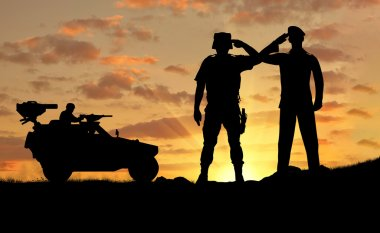 Silhouette of a soldier and the commander