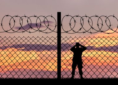 Silhouette of a military border guard