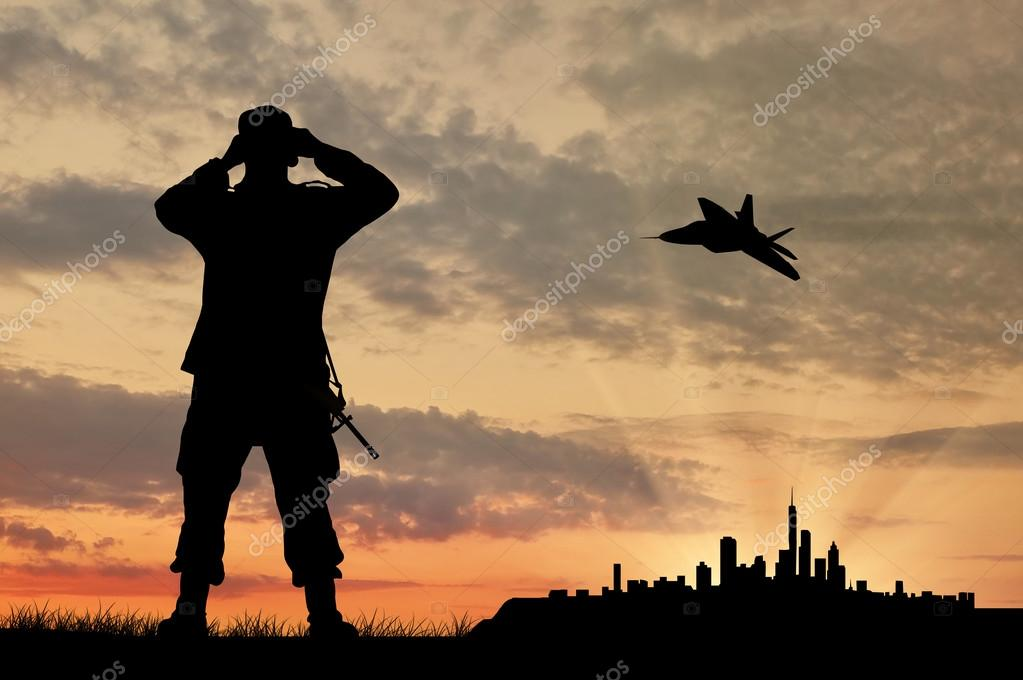 Silhouette of a soldier and an airplane