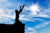 Photo Silhouette of man praying