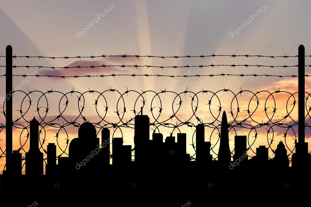 Silhouette of fence and cities away