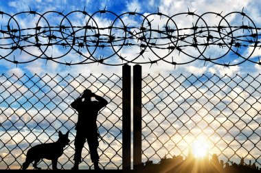 Silhouette of a border guard with a dog
