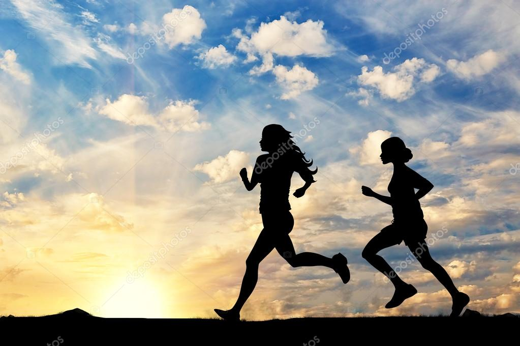 Silhouette of two girls running competition — Stock Photo © Prazisss  #88663546