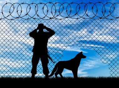 Silhouette of a border guard and a dog