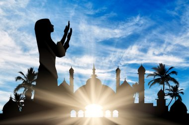 Silhouette of praying woman