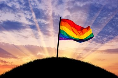 Rainbow flag on a hilltop