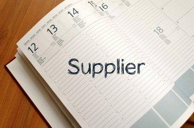 Supplier write on notebook