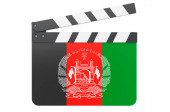Movie clapperboard with Afghan flag, film industry concept. 3D rendering isolated on white background