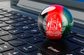 Afghan flag on laptop keyboard. Online business, e-education, shopping in Afghanistan concept. 3D rendering