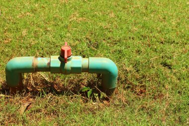 water pipes on the green grass